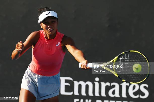 Leylah Annie Fernandez of Canada plays a forehand in her Junior's Doubles match with partner Sasha Wood of the United States Marta Custic of Spain...