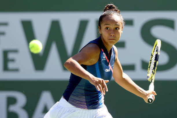 Leylah Fernandez of Canada returns a shot to Shelby Rogers during the BNP Paribas Open at the Indian Wells Tennis Garden on October 12, 2021 in...