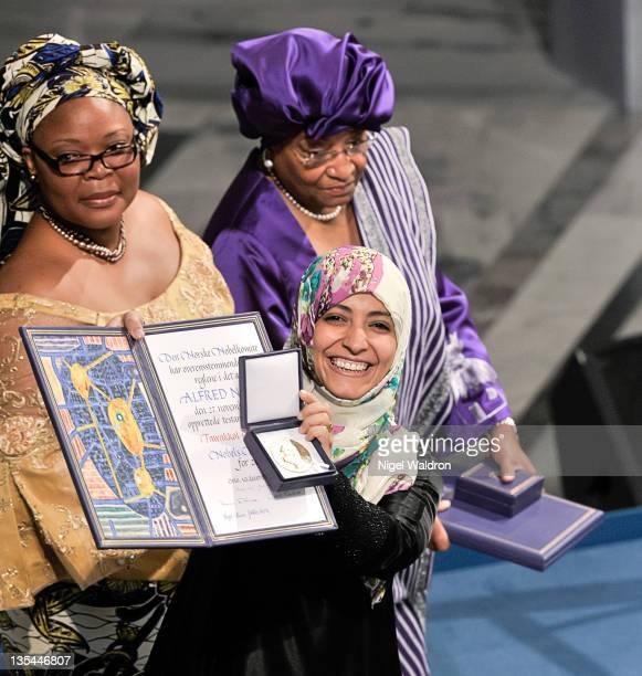 Leymah Gbowee of Liberia Ellen Johnson Sirleaf President of Liberia and Tawakkol Karman of Yemeni joint winners of the Nobel Peace Prize pose during...