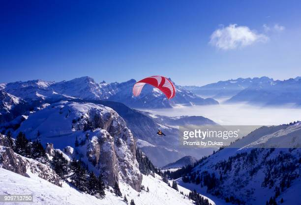 Leysin mountains Vaud VD Vaud Alps Switzerland snow winter Aigle paraglider