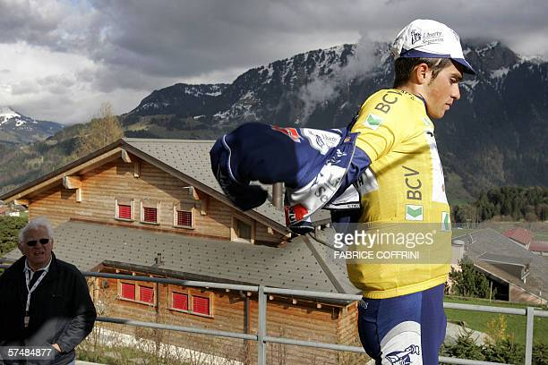 New overall leader Spain's Alberto Contador Velasco puts a jacket on after taking the yellow jersey in the third stage of the sixday Tour of Romandie...