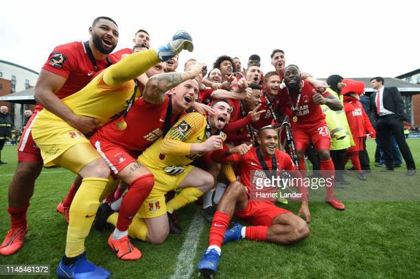 Leyton Orient players celebrate as they win the title after the Vanarama National League match between Leyton Orient and Braintree Town at Brisbane...