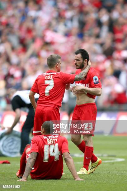 Leyton Orient's Chris Dagnall is consoled by teammate Dean Cox after the game after his penalty was saved by Rotheham United goalkeeper Adam Collin
