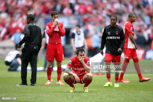 Leyton Orient's Chris Dagnall is left dejected after the game after his penalty was saved by Rotheham United goalkeeper Adam Collin