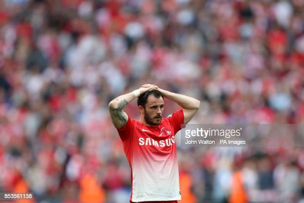 Leyton Orient's Chris Dagnall is left dejected after the game after his penalty was saved by Rotheham United goalkeeper Adam Collin to hand victory...