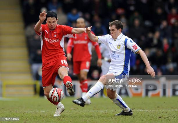 Leyton Orient's Sean Thornton and Leeds United's Neil Kilkenny battle for the ball