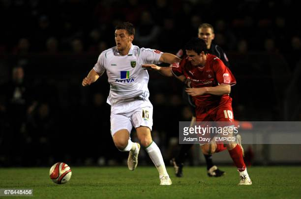 Leyton Orient's Sean Thornton and Norwich City's Chris Martin battle for the ball