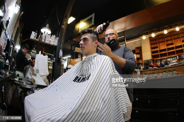 Leyton Rivera of Team Norway has a haircut during a visit to Uncle Joe's Barbers on King Street during day two of the 2020 ATP Cup Group Stage at RAC...