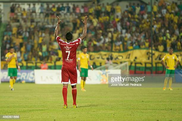 Leyvin Balanta of America de Cali celebrates after socvring the first goal of his team from the penalty sport during a match between America de Cali...
