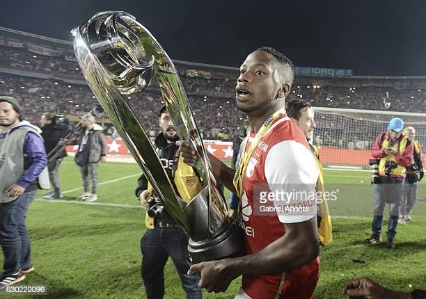 Leyvin Balanta of Santa Fe celebrates with the trophy after a second leg final match between Santa Fe and Deportes Tolima as part of Liga Aguila II...