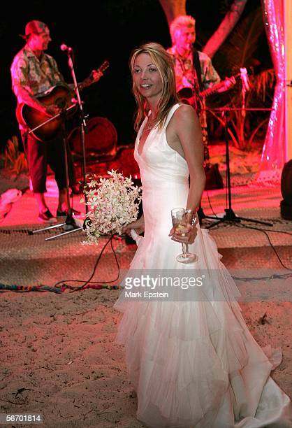 Lhotse Merriam looks on as Rancid perform in the background during her wedding reception January 12 2006 on the Island of Tavarua in Fiji