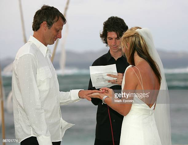 Lhotse Merriam places a wedding band on Tony Hawk's finger during their wedding ceremony January 12 2006 on the Island of Tavarua in Fiji
