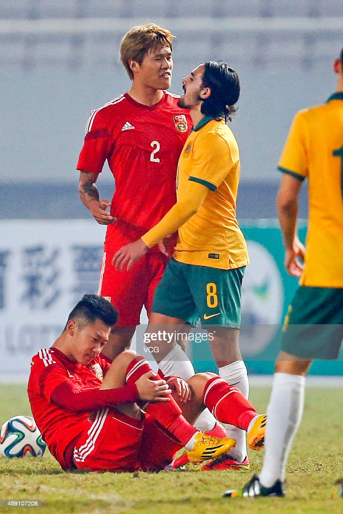 Li Ang #2 of China argues with Ryan Marc Edwards #8 of Australia during the match between China U22 and Australia U22 on day three of the 'Wuhan City of Automobile' International Youth Football Tournament at Wuhan Sports Center Stadium on November 16, 2014 in Wuhan, China.