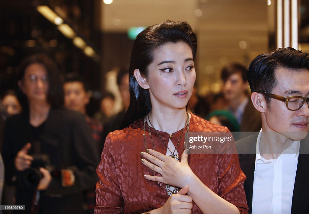 Li Bingbing looks around the store at the Gucci Flagship store opening at Taipei101 on November 22, 2012 in Taipei, Taiwan.