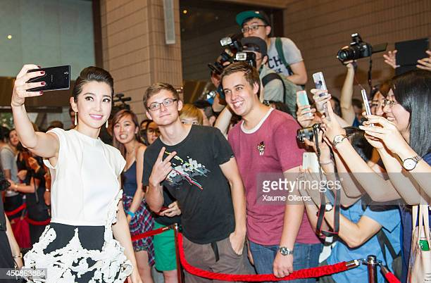 Li Bingbing poses with fans at the worldwide premiere screening of Transformers Age of Extinctionat the on June 19 2014 in Hong Kong Hong Kong