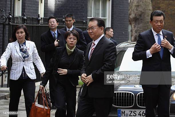 Li Changchun Of The Chinese Communist Party and his entourage arrive at 10 Downing Street on April 17, 2012 in London, England. Mr Chanchun is due to...