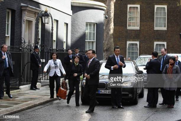 Li Changchun Of The Chinese Communist Party and his entourage arrive at 10 Downing Street on April 17 2012 in London England Mr Chanchun is due to...