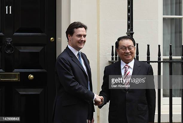 Li Changchun Of The Chinese Communist Party is greeted by Chancellor of the Exchequer George Osborne in Downing Street on April 17, 2012 in London,...