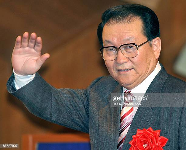 Li Changchun standing committee member of Chinese Communist Party's Political Bureau waves to people during his welcoming reception held by...