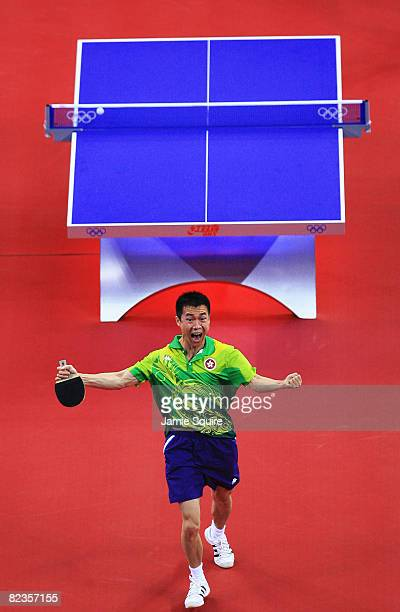 Li Ching of Hong Kong China celebrates after defeating Chiang Peng-Lung of Chinese Taipei during a Men's Team Bronze Play-off Round 1 match at the...