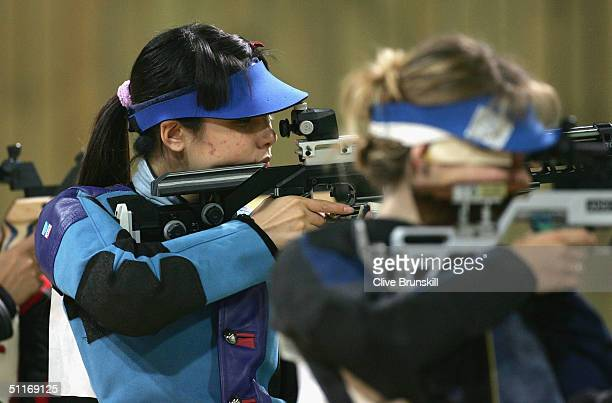 Li Du of China competes during the women's 10 metre air rifle finals on August 14 2004 during the Athens 2004 Summer Olympic Games at the Markopoulo...
