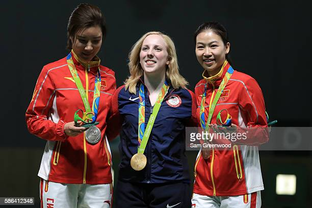 Li Du of China with silver Virginia Thrasher of the United States with gold and Siling Yi of China with bronze pose on the podium following the...