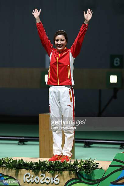 Li Du stands on the podium after winning silver in the 10m Air Rifle Women's final on Day 1 of the Rio 2016 Olympic Games at the Olympic Shooting...