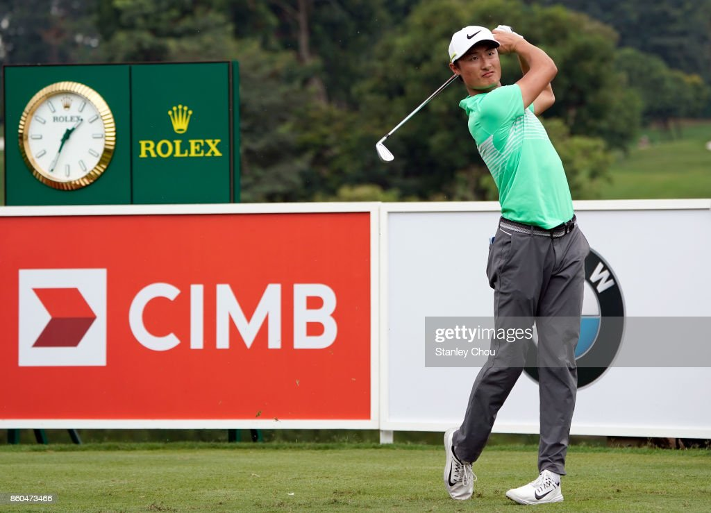 Li Hao Tong of China plays a shot on the 16th hole during round one of the 2017 CIMB Classic at TPC Kuala Lumpur on October 12, 2017 in Kuala Lumpur, Malaysia.