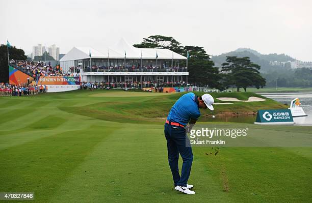 Li Hao Tong of China plays his approach shot on the 18th hole during the play off against Kiradech Aphibarnrat of Thailand afterthe final round of...