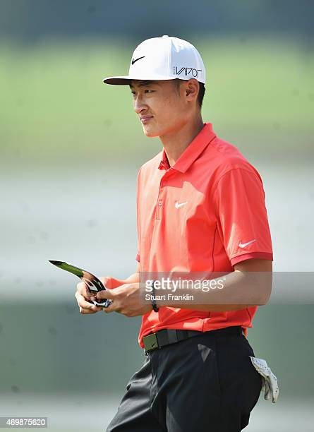 Li Hao Tong of China ponders a shot during the first round of the Shenzhen International at Genzon Golf Club on April 16 2015 in Shenzhen China