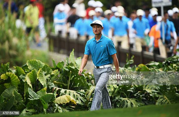 Li Hao Tong of China walks during the third round of the Shenzhen International at Genzon Golf Club on April 18 2015 in Shenzhen China