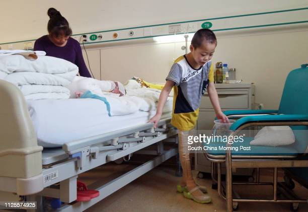 Li Haoren is pictured at the PLA 304 Hospital in Beijing on Jul 17 2013 The two boys Li Haoren eight years old and his younger brother Li Hao 4 four...