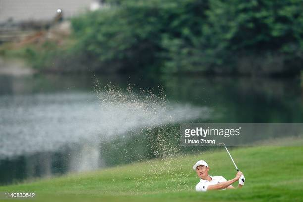 Li Haotong of China plays a shot during day two of the 2019 Volvo China Open at Genzon Golf Club on May 3 2019 in Chengdu China