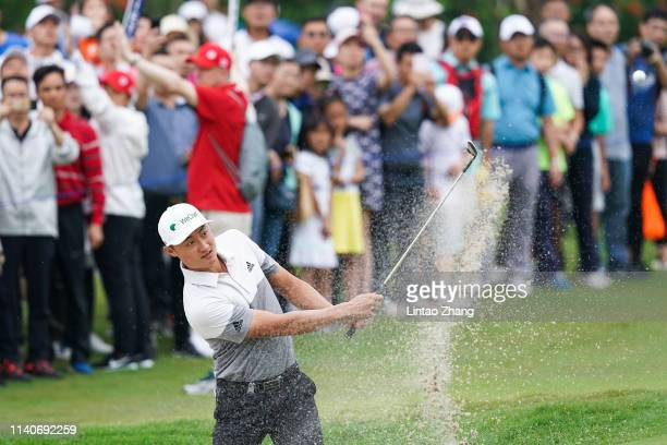 Li Haotong of China plays a shot during the day one of the 2019 Volvo China Open at Genzon Golf Club on May 2 2019 in Shenzhen China