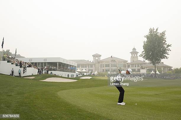 Li Haotong of China plays a shot during the final round of the Volvo China open at Topwin Golf and Country Club on May 1 2016 in Beijing China