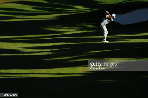 Li Haotong of China plays his second shot on the 11th hole during the third round of the Turkish Airlines Open at Regnum Carya Golf Spa Resort on...