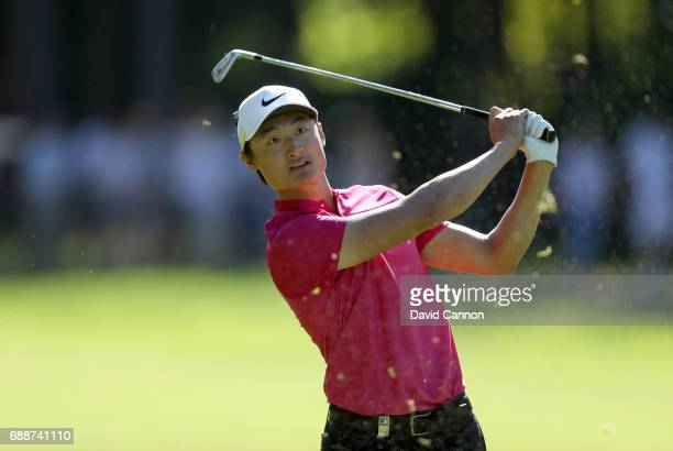 Li Haotong of China plays his second shot on the par 4 15th hole during the second round of the 2017 BMW PGA Championship on the West Course at...