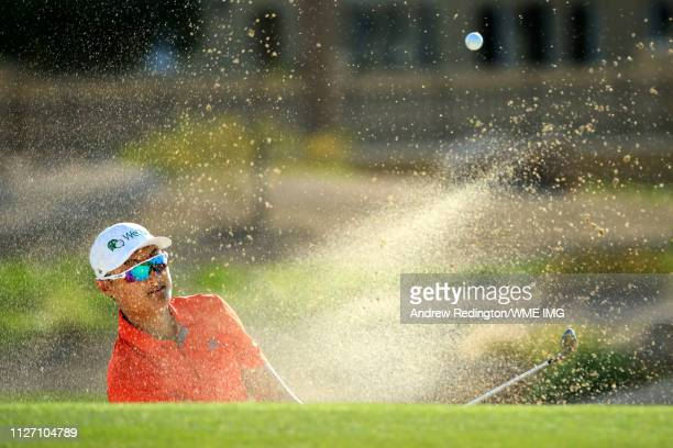 Li Haotong of China plays out of a greenside bunker on the 13th hole during Day four of the Saudi International at the Royal Greens Golf Country Club...