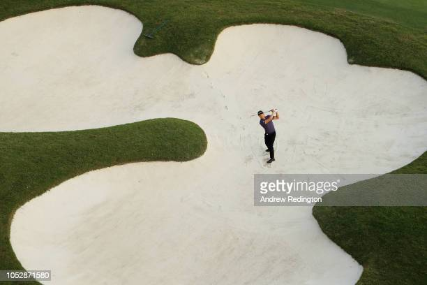 Li Haotong of China poses for a photo in a bunker during the proam prior to the WGC HSBC Champions at Sheshan International Golf Club on October 24...