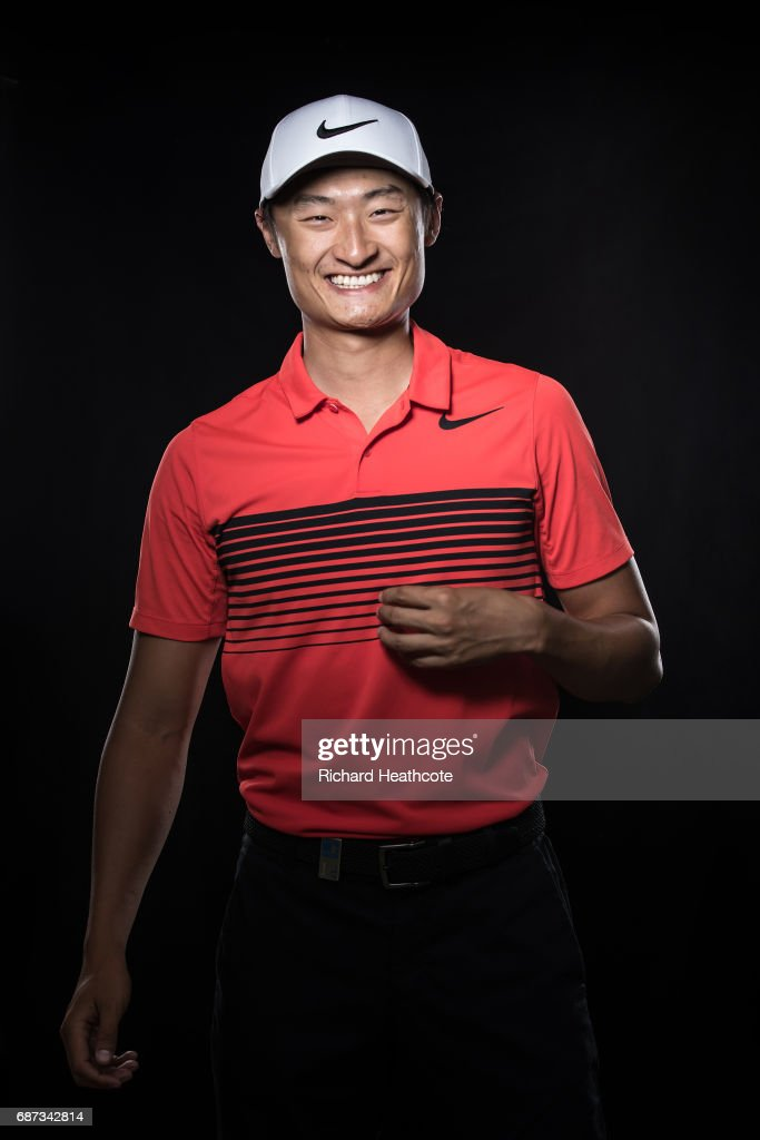 Li Haotong of China poses for a portrait during a practise round for the BMW PGA Championship at Wentworth on May 23, 2017 in Virginia Water, England.