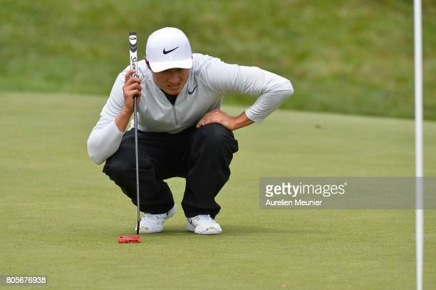 Li Haotong of China reacts during day four of the HNA Open de France at Le Golf National on July 2 2017 in Paris France