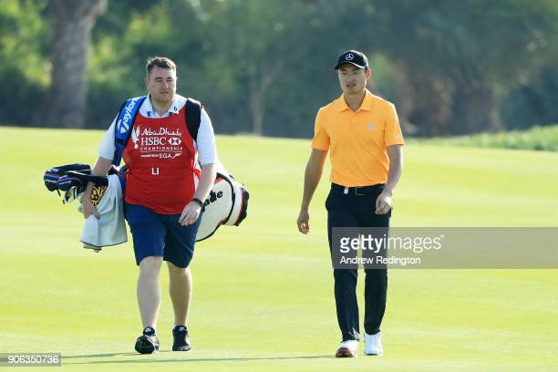 Li Haotong of China walks on the 13th hole during round one of the Abu Dhabi HSBC Golf Championship at Abu Dhabi Golf Club on January 18 2018 in Abu...