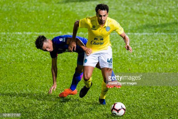 Li Hoi Ngai of Kitchee SC fights for the ball with Diogo Luis Santo of Buriram during the Preseason Friendly Match between Kitchee and Buriram United...