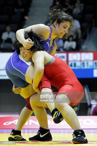 Li Hui of China competes against Michelle Fazzari of Canada in the 59kg division of the third place playoff match between China and Canada during day...