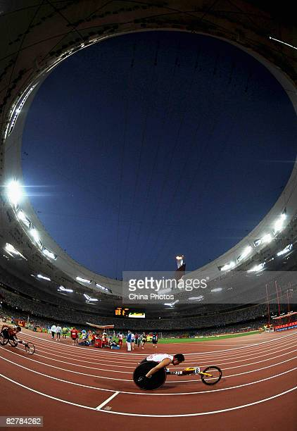 Li Huzhao of China competes in the Men's 400m T53 Final Athletics event at the National Stadium during day five of the 2008 Paralympic Games on...