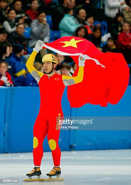 Li Jiajun of China celebrates after finishing in third place in the final competition of the Men's 1000 metre at World Short Track Speed Skating...