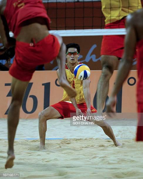 Li Jian of China retrieves a shot during the beach volleyball men's final match at the 16th Asian Games in Guangzhou on November 24 2010 Xu Linyin...