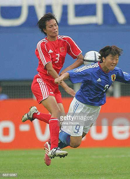 Li Jie of China vies for a ball with Nagasato of Japan during a match in the East Asian Football Federation Women's Cup 2005 on August 3, 2005 in...