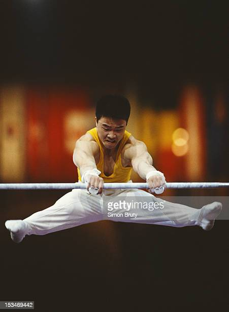 Li Jing of China performs during the Men's Parallel barsevent on 1st October 1992 during the World Artistic Gymnastics Championships at the Palais...