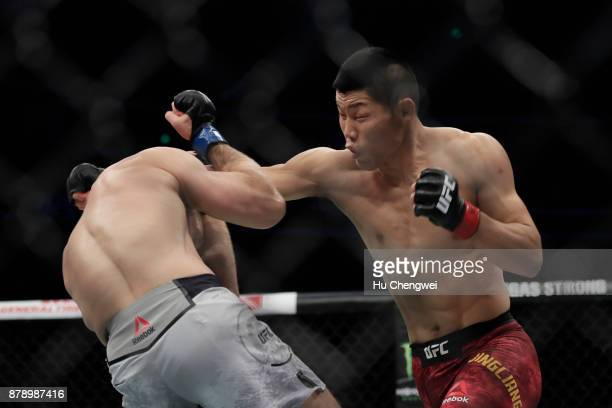 Li Jingliang fights with Zak Ottow during the UFC Fight Night at MercedesBenz Arena on November 25 2017 in Shanghai China